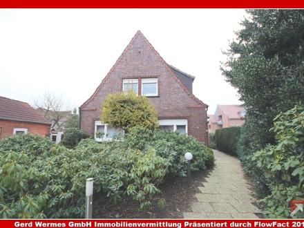 Einfamilienhaus mit Teilkeller & 2 Garagen im Stadtzentrum von Haren zu verkaufen!