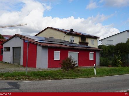 Wohn- und Geschäftsgebäude mit Produktionshalle und Photovoltaikanlage