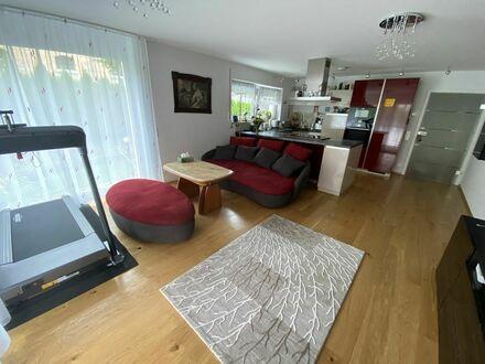 Schicke 4,5 Zimmerwohnung mit Terasse und Garten im Neubau