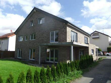 Für Kapitalanleger! Langfristig vermietete 4 ZKB-Neubau-Eigentumswohnung mit Terrasse und Garten in ruhiger Lage von Bad…