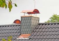 Kaminhaube: Schutz vor Regen, Wind und Vogelnest