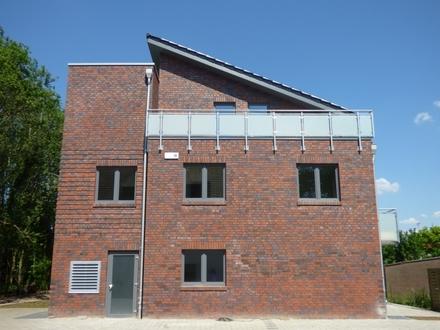 Erstbezug ab Juli: Energieeffiziente Erdgeschosswohnung mit Terrasse in zweiter Reihe zur Alexanderstraße!
