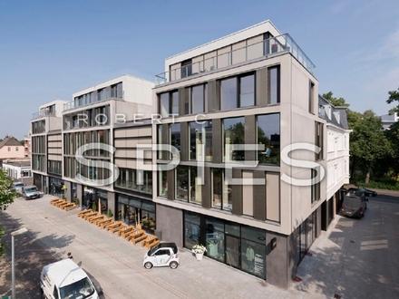 Individuelle, hochwertige 4-Zimmer-Wohnung über 2 Ebenen mit großzügigem Patio, Dachterrasse und Balkon