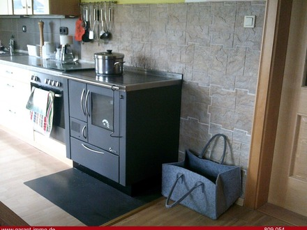 Einbauküche mit Holzofen