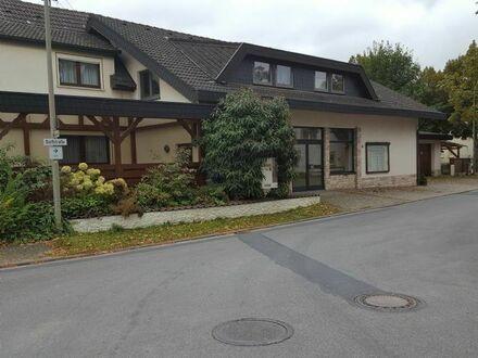 2-Familienwohnhaus mit Laden/Büro