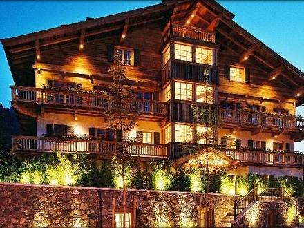 Kitzbühel : zentrumsnahe Villenetage mit 335 qm edler Wohnfläche, SPA-Bereich, Nähe Ganslernlift!