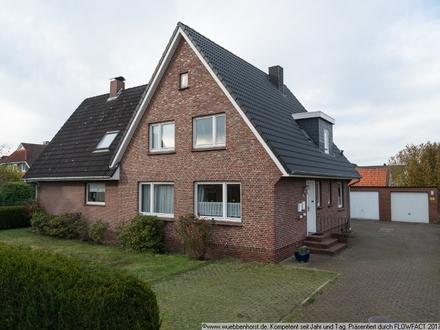 Vermietetes Zweifamilienhaus mit massiven Nebengebäuden und großem Grundstück