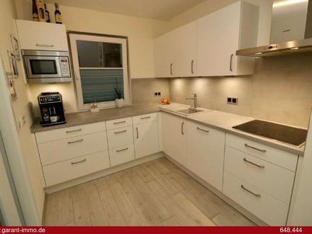 TOP sanierte Wohnung mit großer überdachter Terrasse, großer Garten, Einzelgarage und viel Stauraum!