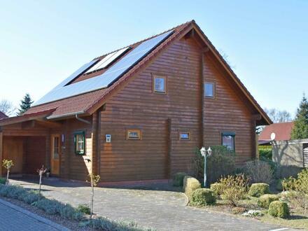 Wohnen wie im Urlaub! Finnisches Blockholzhaus mit Carport in Aurich-Tannenhausen