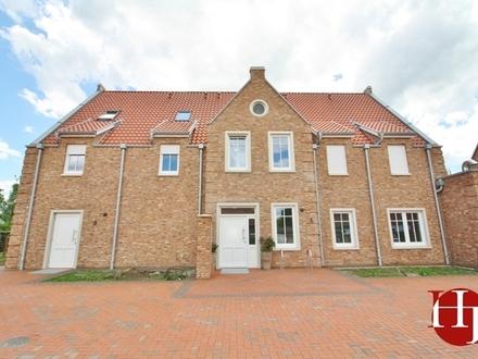 Neubau: Architektonisch hochwertiges Wohn- und Geschäftshaus mitten in Leeste