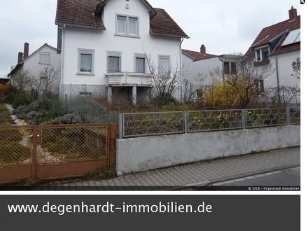 Sanierungsobjekt mit Wohnhaus, Nebengebäuden und Garage in ruhiger Zentrumslage