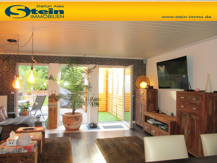 Ruhig gelegene, moderne Wohnung mit riesiger Terrasse und geschmackvoll angelegtem Garten!