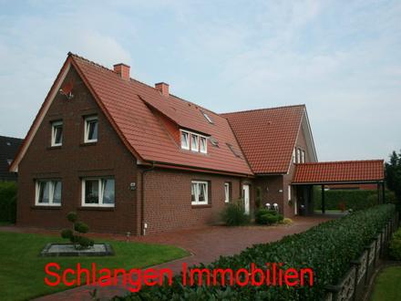 Objekt: 18/707 Einfamilienhaus mit Einliegerwohnung und angrenzendem Grundstück und Doppelcarport im Feriengebiet Saterland…