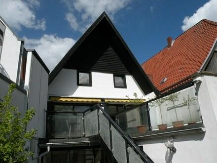 rückwärtige Ansicht mit Terrasse Wohnung