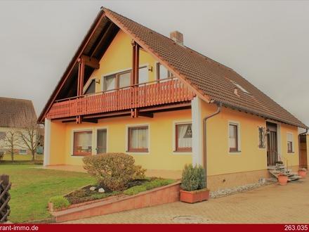 Top gelegenes Einfamilienhaus mit Einliegerwohnung und großem Garten!