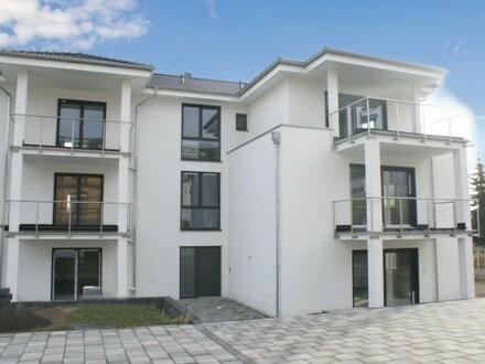 Schwellenfreie 3-Zi.-Neubauwohnung mit Terrasse, Garten und Kfz-Stellplatz