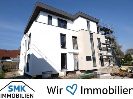 Neubau-Erdgeschosswohnung im Herzen von Schloß Holte!