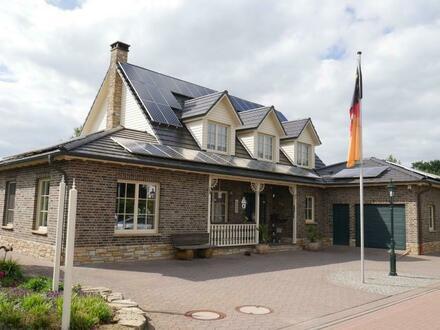 Traumhafte Lage und Qualität pur! Großzügiges Einfamilienhaus im Landhaus-Stil in Lohne