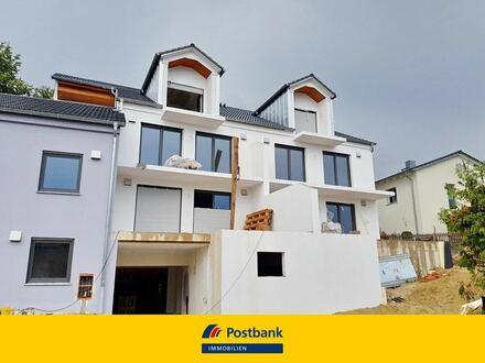 Attraktive 4 Zi.-EG-Wohnung in einem neu erstellten und energiesparenden 6 Fam.-Haus