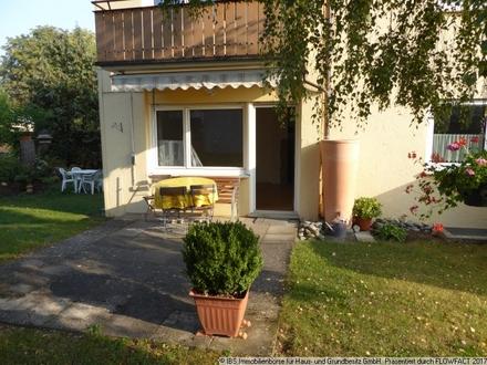 Helle und freundliche Wohnung im Erdgeschoss mit Garten und Garage