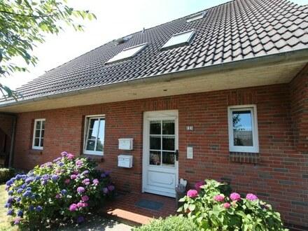 Attraktive Rendite durch Vermietung! Vermietete EG-Eigentumswohnung mit Terrasse sowie Carportanlage