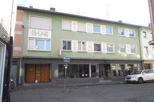 Mehrfamilienhaus mit Ladengeschäft