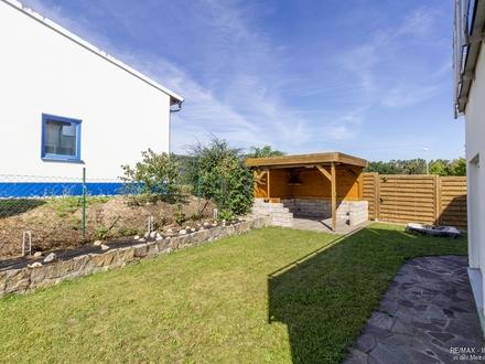Attraktive Wohnung mit Gartenanteil