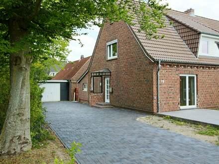 Komplett neu ausgebaute Haushälfte mit viel Nutzfläche für Hobby und Co.