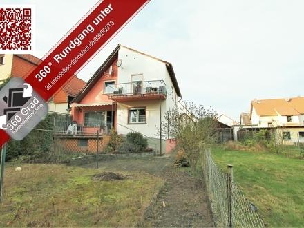 Zweifamilienhaus mit Hof, Garten und Tiefgaragenstellplatz im Ortskern von Mörfelden.