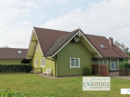 Charmantes Holzhaus mit pflegeleichtem Garten und Carport in ruhiger Lage! Ideal für Familien.