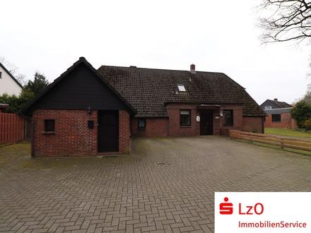 Ein-/Zweifamilienhaus mit großer Garage und Werkstatt