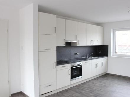 Neuwertige Obergeschosswohnung in Haren am Kanal mit Einbauküche u. Balkon ! Zentral !