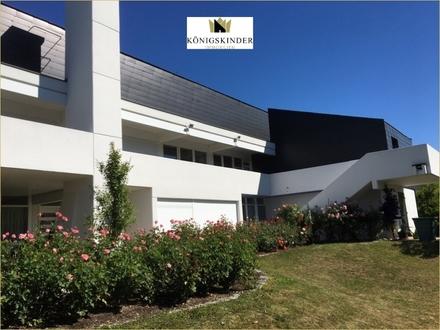 Individuelle & repräsentatives Architektenhaus mit ELW in unverbaubarer Aussichtslage!