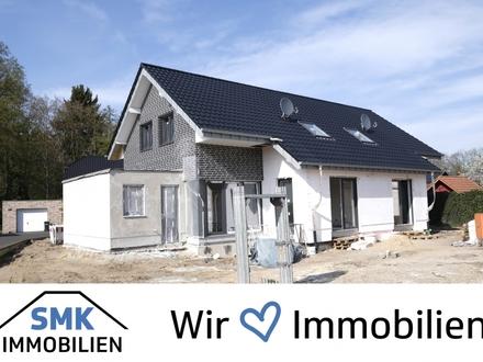 Neubau-Doppelhaushälfte mit Keller und Garage!