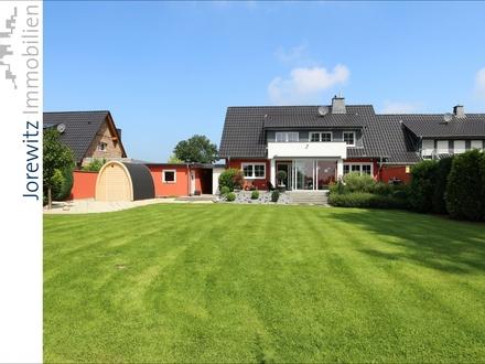 Wohntraum im Grünen: Exklusives und modernes Einfamilienhaus in Spenge mit tollem Gartengrundstück