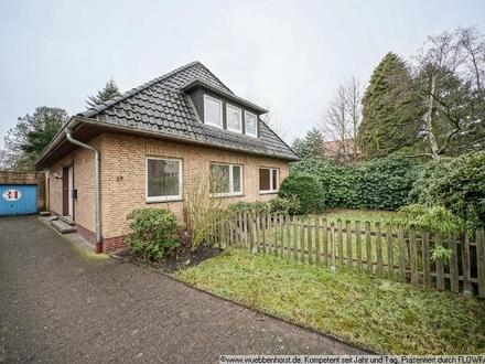 Gepflegtes Einfamilienhaus mit Teilkeller, Garage und schönem Gartengrundstück