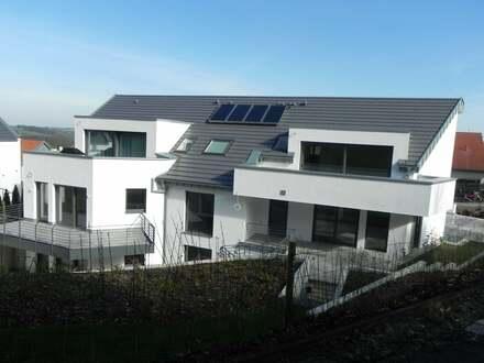 Eigentumswohnung mit Süd-Balkon und eigenem Gartenanteil