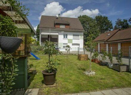Schicke 3-Zimmer-Wohnung mit eigenem Gartenanteil