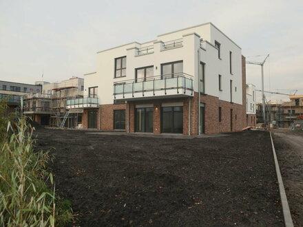 Lichtdurchflutete ebenerdige Neubauwohnung mit großer Terrasse!