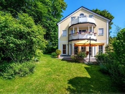 Luxuriöse Erdgeschosswohnung mit malerisch angelegtem Gartenparadies