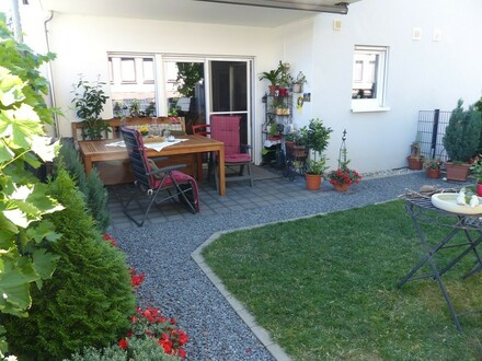 Schwellenfreie Erdgeschosswohnung mit Terrasse u. eigenem Garten