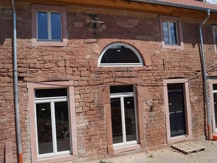 Modernes Wohnen in Sandsteinfassade