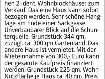Anzeigentitel Räbke-Ferienpark Nord-Elm, es stehen 2 ident. Wohnblockhäuser...