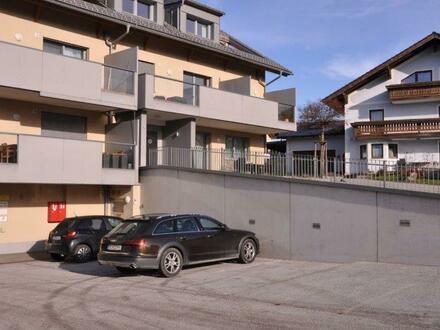 2-Zimmer-Wohnung mit Terrasse, Garten und Tiefgaragenstellplatz