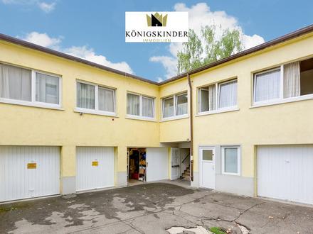 Bad Cannstatt: Wohn- und Geschäftshaus in zentraler Lage