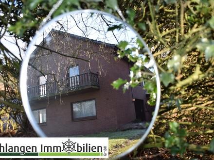 Objekt Nr. 19/805 Zweifamilienhaus mit Einliegerwohnung, D- Carport und Geräteraume im Seemannsort Barßel OT Harkebrügge