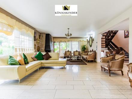 Großzügiges Einfamilienhaus mit Einliegerwohnung und Gewerbeeinheit + Garten