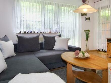 Gemütliche Wohnung mit hübschem Garten in begehrter Lage