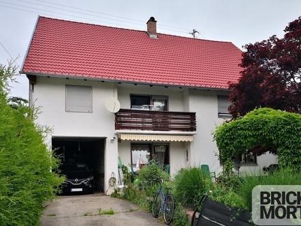 Einfamilienhaus mit Lagerhalle und Kfz-Werkstatt-Grube