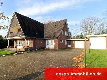 Großzügiges Zweifamilienhaus mit Garage, Wohnmobilcarport und Terrasse in Ostenfeld